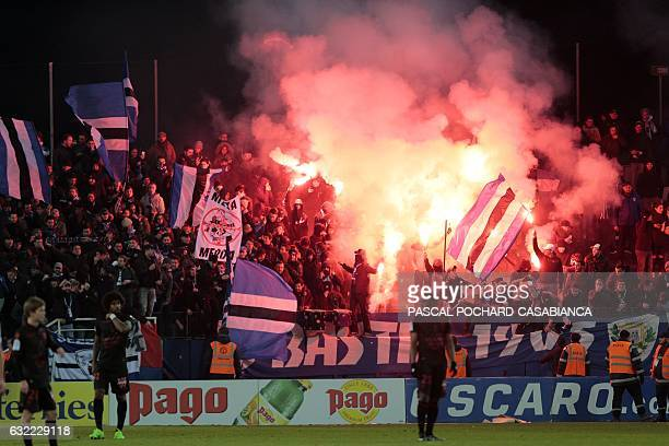 Bastia's supporters celebrate during the L1 football match between Bastia and Nice on January 20 2017 at the Armand Cesari stadium in Bastia on the...