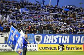 Bastia's supporters cheer their team before the French L1 football match Bastia against Lyon on November 22 2014 in the Armand Cesari stadium in...