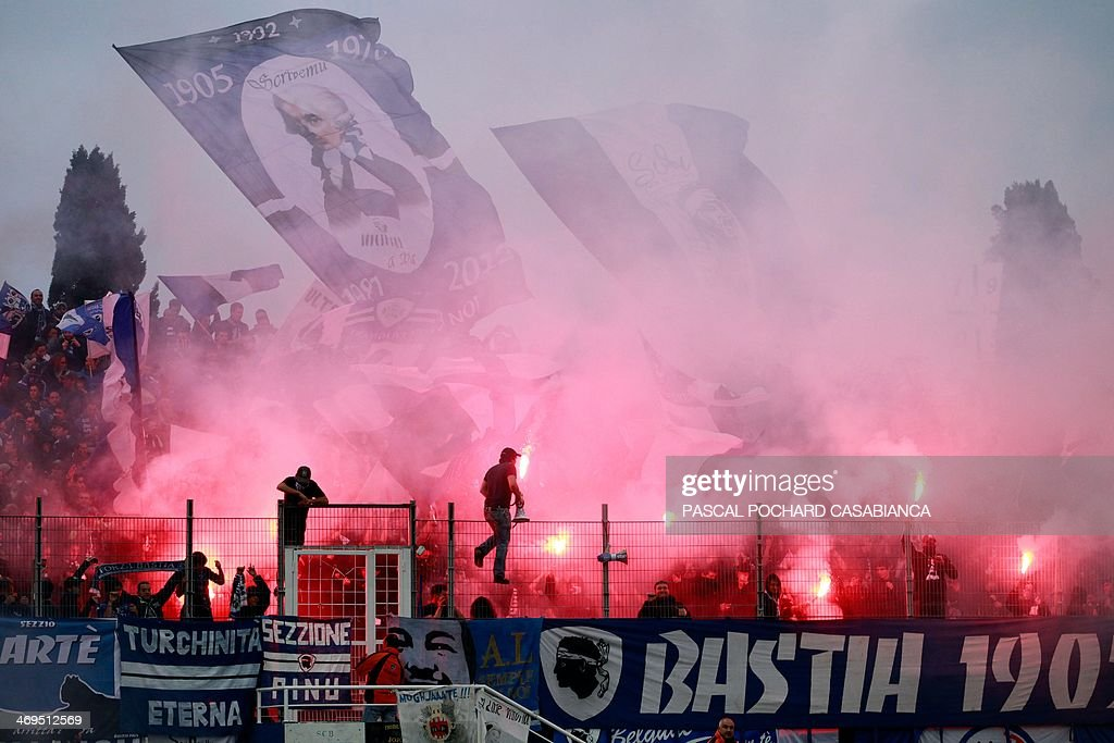 Bastia's supporters cheer their team prior to the French L1 football match Bastia (SCB) vs Monaco (ASM) at the Armand Cesari stadium in Bastia, Corsica island, on February 15 , 2014. AFP PHOTO / PASCAL POCHARD-CASABIANCA