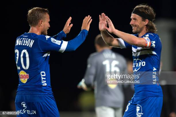 Bastia's Swedish midfielder Pierre Bengtsson and Bastia's French midfielder Yannick Cahuzac celebrate at the final whistle of the French L1 football...