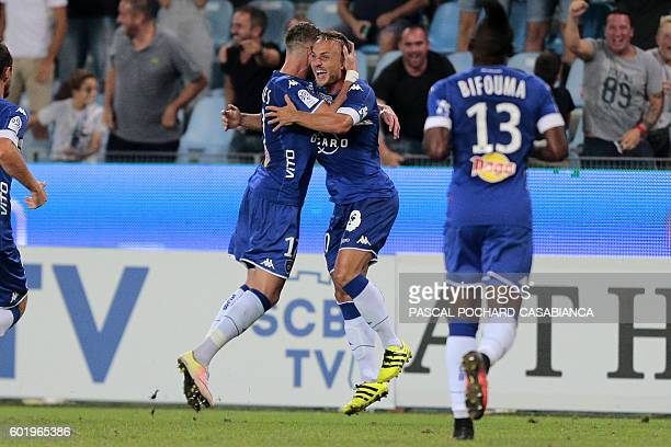 Bastia's Swedish midfielder Pierre Bengtsson is congratulated by teammates after scroring a goal during the French L1 football match between Bastia...