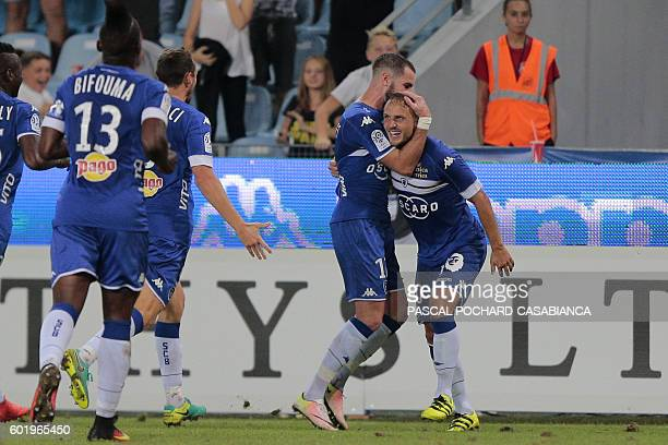 Bastia's Swedish midfielder Pierre Bengtsson is congratulated by teammates after scroring a goal during the French Ligue 1 football match between...