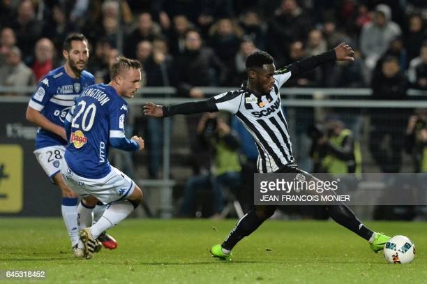 Bastia's Swedish midfielder Pierre Bengtsson vies with Angers' French forward Jonathan Bamba during the French L1 football match between Angers and...