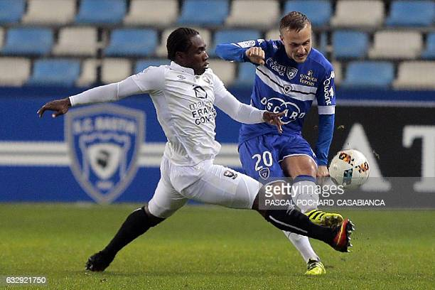 Bastia's Swedish midfielder Pierre Bengtsson vies with Caen's Haitian forward Jeff Louis during the L1 football match between Bastia and Caen on...