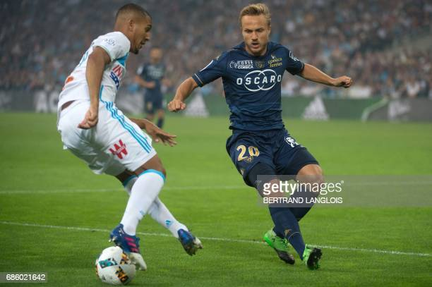 Bastia's Swedish midfielder Pierre Bengtsson vies with Marseille's French midfielder William Vainqueur during the French L1 football match Olympique...