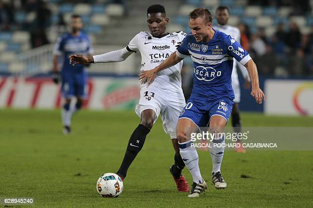 Bastia's Swedish midfielder Pierre Bengtsson vies with Metz's French forward Opa Nguette during the French Ligue 1 football match between Bastia and...