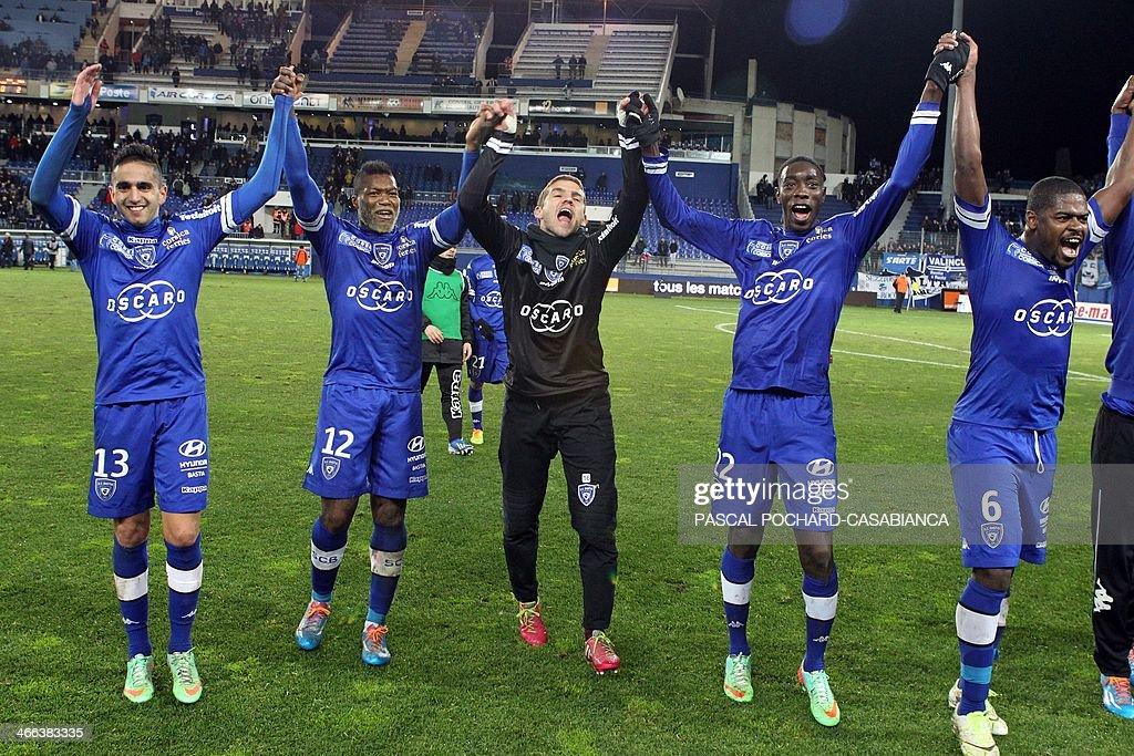 Bastia's team celebrates after the French L1 football match Bastia (SCB) against Guingamp (AEG) in the Armand Cesari stadium in Bastia,French Mediterranean Island of Corsica, on February 1rst , 2014.