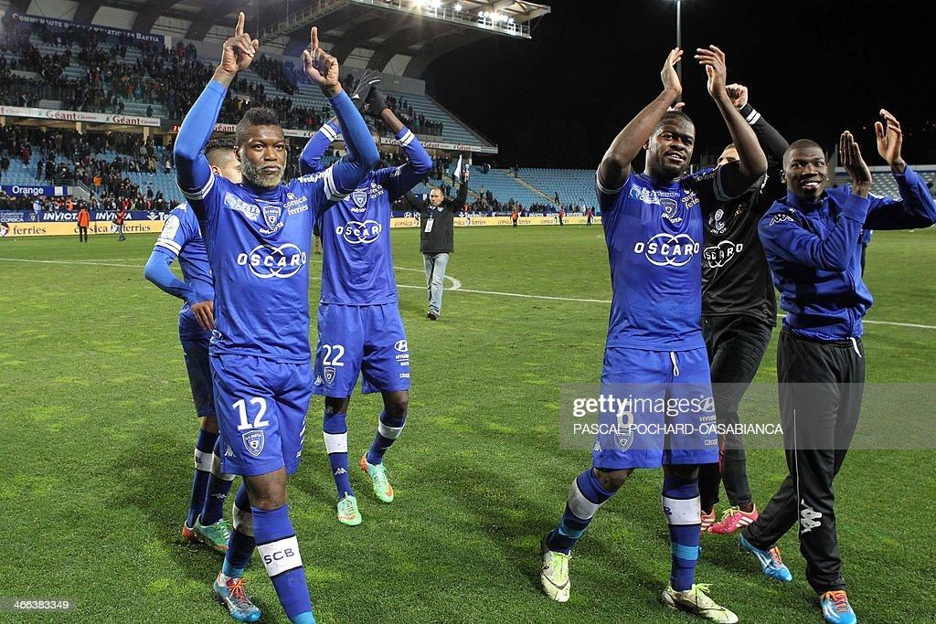 Bastia's team celebrates after winning 3-2 during the French L1 football match Bastia (SCB) against Guingamp (AEG) in the Armand Cesari stadium in Bastia, in the French Mediterranean Island of Corsica, on February 1, 2014.