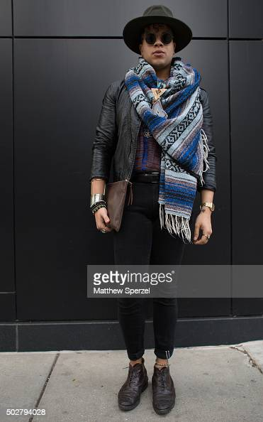 Bastien Allen is seen on Michigan Avenue wearing a black leather HM jacket a purple patterned thrifted South African tunic black Uniqlo pants black...