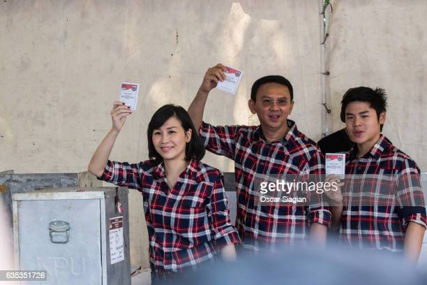 Basuki Tjahaja Purnama and his family show their ballot after voting in the Jakarta Governal Election on February 15 2017 in Jakarta Indonesia...