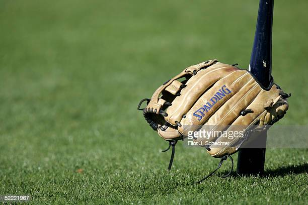A bat and glove are seen prior to morning workouts on February 20 2005 at the Boston Red Sox Minor League Spring Training facility in Fort Myers...
