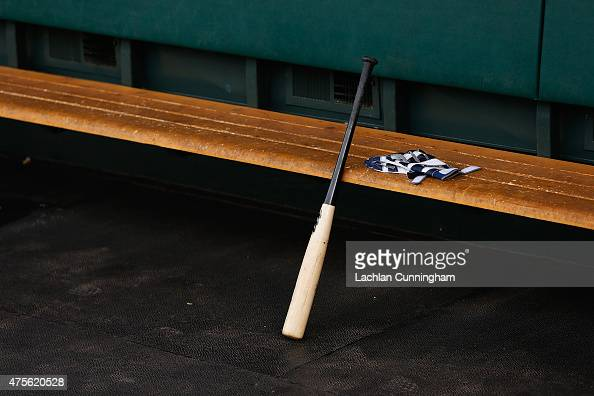 A bat and gloves in the Atlanta Braves dugout before the game against the San Francisco Giants at ATT Park on May 29 2015 in San Francisco California