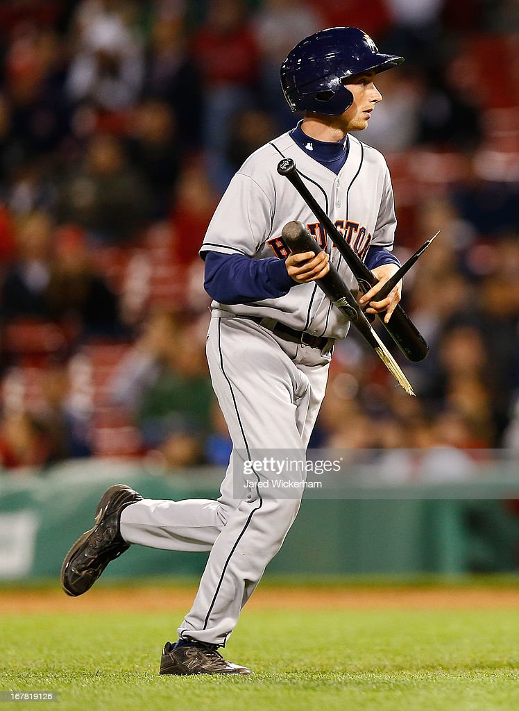 A bat boy collects pieces of a broken bat during the game between the Boston Red Sox and the Houston Astros on April 27, 2013 at Fenway Park in Boston, Massachusetts.