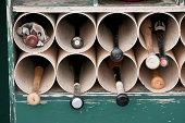 A bat rack in the dugout.
