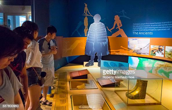 Bata Shoe Museum Visitors looking at vintage shoes in the Shoe History Timeline The museum collects researches preserves and exhibits footwear from...