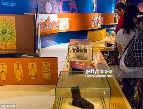 Bata Shoe Museum Visitors looking at vintage shoes inside glass counter The museum collects researches preserves and exhibits footwear from around...