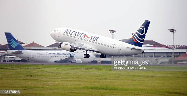 A Batavia Air Indonesian domestic airliner takes off from Bali's Ngurah Rai airport on January 28 2011 where thousands of foreign tourists mostly...