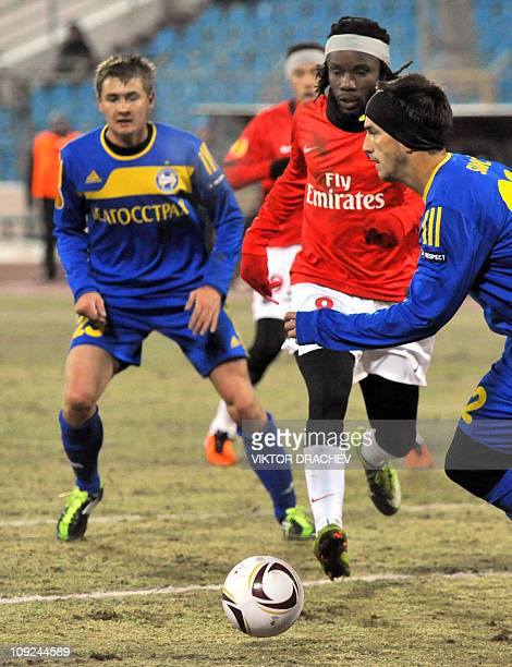 Bate Borisov's Edgar Olekhnovich and Marco Simic vie for the ball with Paris SaintGermain's Peguy Luyindula during their UEFA Europa League Round of...