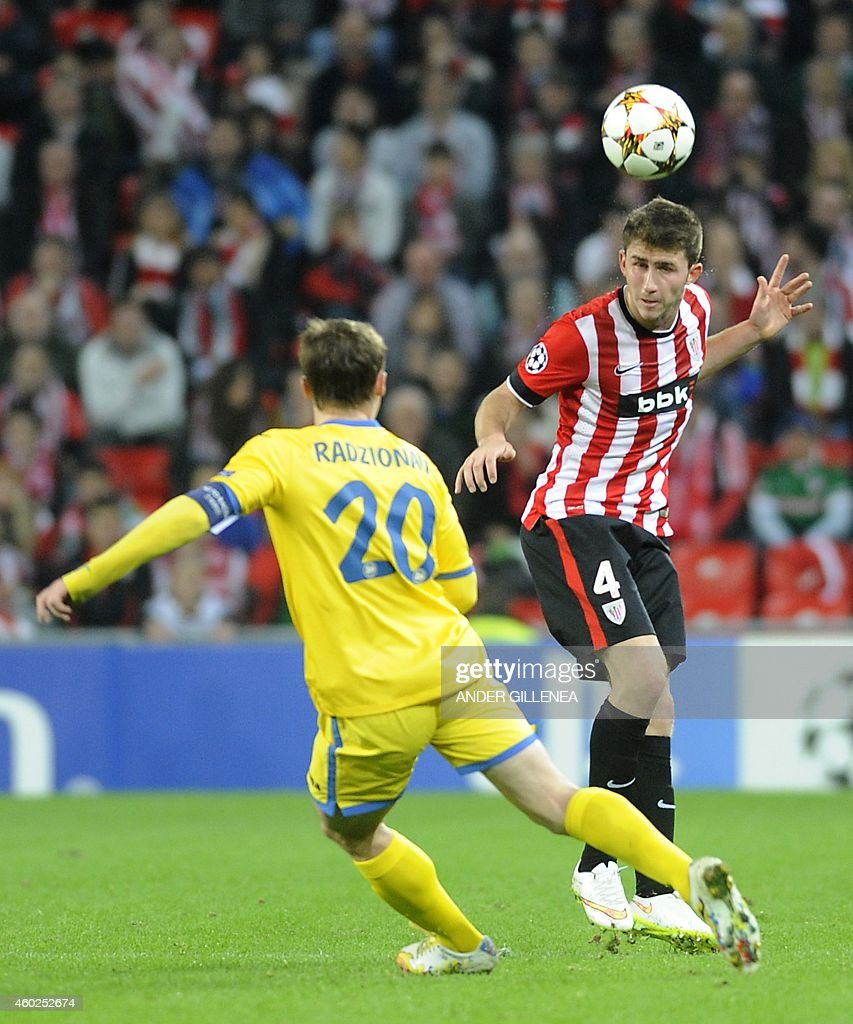 Bate Borisov's forward Vitali Rodionov (L) vies with Athletic Bilbao's French defender <a gi-track='captionPersonalityLinkClicked' href=/galleries/search?phrase=Aymeric+Laporte&family=editorial&specificpeople=7894319 ng-click='$event.stopPropagation()'>Aymeric Laporte</a> during the UEFA Champions League Group F football match FC Barcelona vs Paris Saint-Germain at the Camp Nou stadium in Barcelona on December 10, 2014. AFP PHOTO/ QUIQUE GARCIA