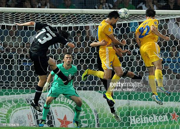 Bate Borisov's player Marko Simic scores against Sturm Graz's Christian Gratzei and Thomas Burgstaller during their UEFA Champions League play off...