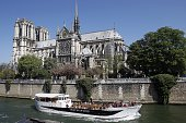 A 'BateauxMouches' a sightseeing riverboat cruise passes by on the river Seine in front of the Paris cathedral NotreDame 'NotreDame de Paris' on...