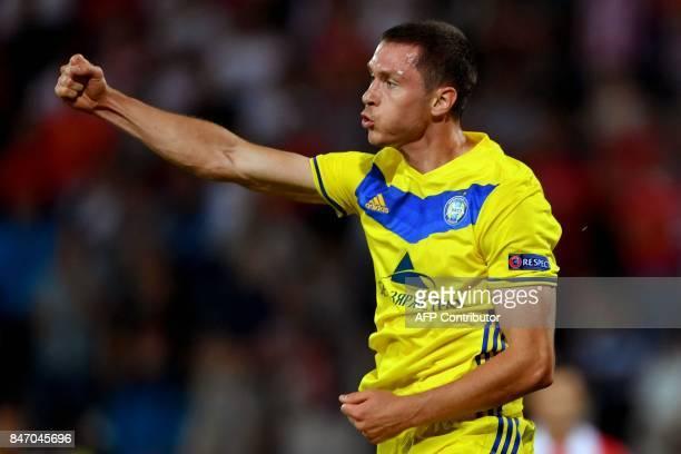 Bate's forward Nikolai Signevich celebrates after scoring a goal during the UEFA Europa League match between FK Crvena Zvezda Beograd and Bate...