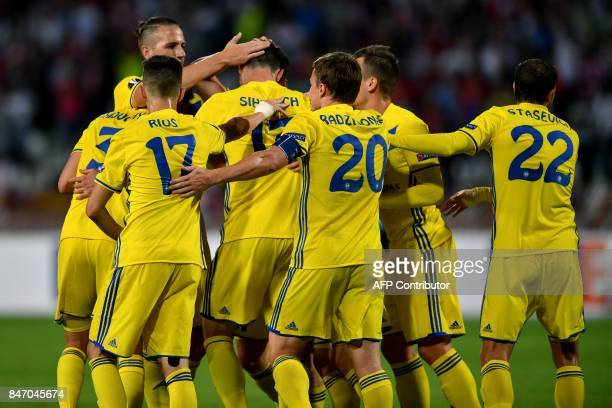 Bate's forward Nikolai Signevich celebrates with teammates after scoring a goal during the UEFA Europa League match between FK Crvena Zvezda Beograd...