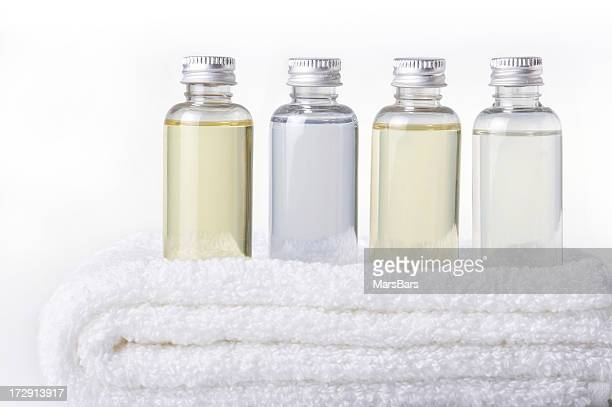 bath bottles on towel