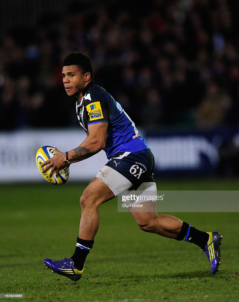 Bath centre <a gi-track='captionPersonalityLinkClicked' href=/galleries/search?phrase=Kyle+Eastmond&family=editorial&specificpeople=4312712 ng-click='$event.stopPropagation()'>Kyle Eastmond</a> starts an attack during the Aviva Premiership match between Bath and Gloucester at Recreation Ground on March 1, 2013 in Bath, England.