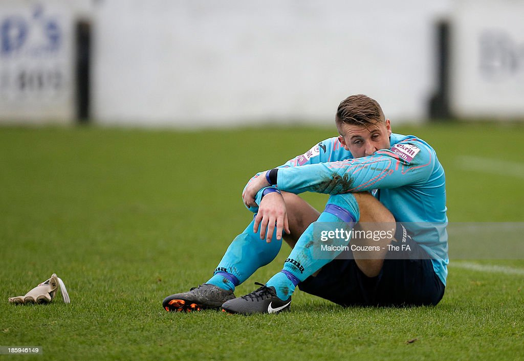 Bath City goalkeeper Jason Mellor sits dejectedly on the pitch at the end of the FA Cup fourth qualifying round match between Bath City and Salisbury at Twerton Park , Bath on October 26th 2013,