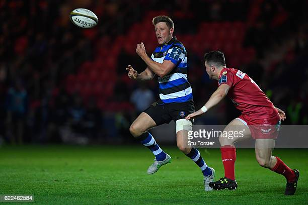 Bath fly half Rhys Priestland sets up the third Bath try with a pass during the AngloWelsh Cup match between Scarlets and Bath at Parc y Scarlets on...