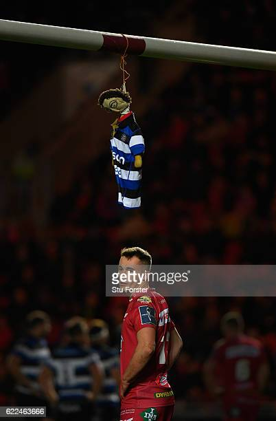 Bath mascot dangles from the Scarlets cross bar as Scarlets centre Ioan Nicholas looks on during the AngloWelsh Cup match between Scarlets and Bath...