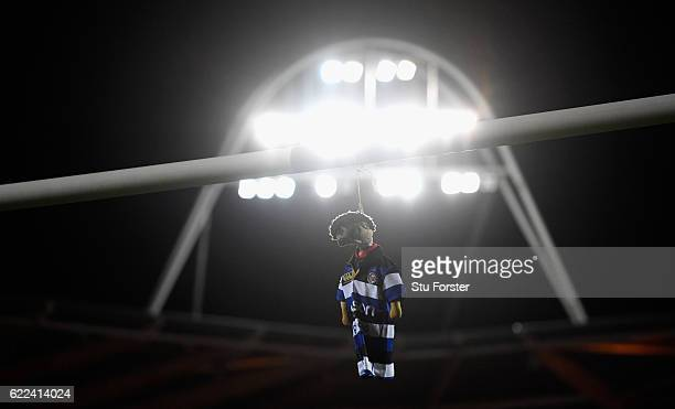 Bath mascot dangles from the Scarlets cross bar during the AngloWelsh Cup match between Scarlets and Bath at Parc y Scarlets on November 11 2016 in...