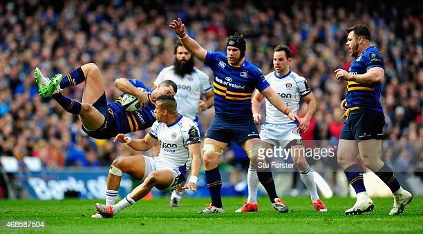 Bath player Anthony Watson puts in a late challenge on Rob Kearney of Leinster and is yellow carded during the European Rugby Champions Cup Quarter...