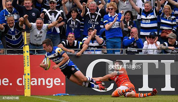 Bath player George Ford goes over to score despite the tackle of Tommy Bell of the Tigers during the Aviva Premiership semi final match between Bath...