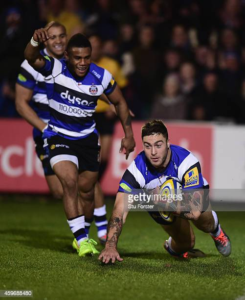 Bath player Matt Banahan dives over to score the first try as Kyle Eastmond celebrates during the Aviva Premiership match between Bath Rugby and...