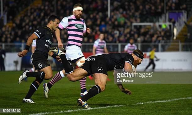 Bath player Ross Batty crosses for the first Bath try during the European Rugby Challenge Cup match between Bath Rugby and Cardiff Blues at The...