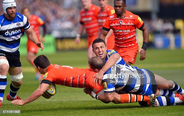 Bath player Sam Burgess and Paul James combine to tackle Tigers player Ben Youngs during the Aviva Premiership semi final match between Bath Rugby...