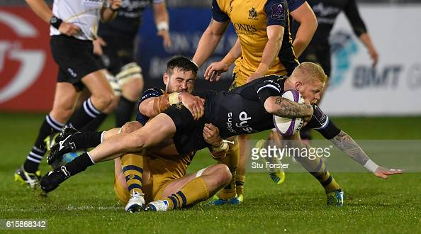 Bath player Tom Homer is tackled by Jonathan Fisher of Bristol during the European Rugby Challenge Cup match between Bath Rugby and Bristol at the...