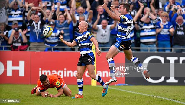 Bath players Peter Stringer and George Ford celebrate after Stringer had scored as Tommy Bell of the Tigers looks on during the Aviva Premiership...