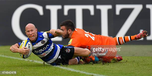 Bath players Peter Stringer scores despite the tackle of Tommy Bell of the Tigers during the Aviva Premiership semi final match between Bath Rugby...