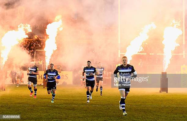 Bath Rugby players are greeted by pyrotechnics as they run onto the pitch prior to the Aviva Premiership match between Bath Rugby and Gloucester...