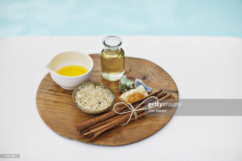Bath salts and massage oils at poolside : Stock Photo