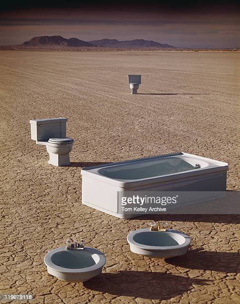 Bath, sink and toilet on arid landscape