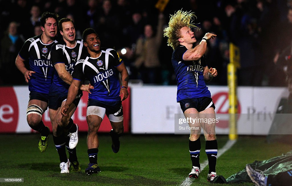 Bath wing Tom Biggs (r) celebrates his try with team mates during the Aviva Premiership match between Bath and Gloucester at Recreation Ground on March 1, 2013 in Bath, England.
