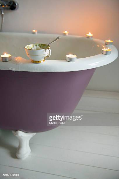 Bath with candles and tea-cup