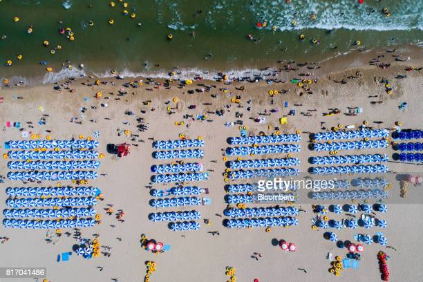 Bathers are seen on the beach and in the sea in this aerial photograph taken above Haeundae beach in Busan South Korea on Sunday July 16 2017 South...