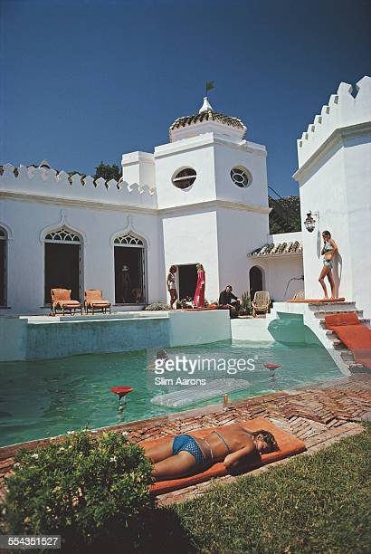 Bathers by the pool at the home of Vanessa Somers McConnell at El Cuartón Costa de la Luz Spain August 1971