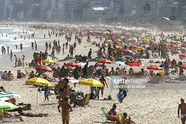 Bathers crowd Ipanema beach in Rio de janeiro Brazil on August 19 2008 to find relief from the high temperatures caused by a heat wave that made the...