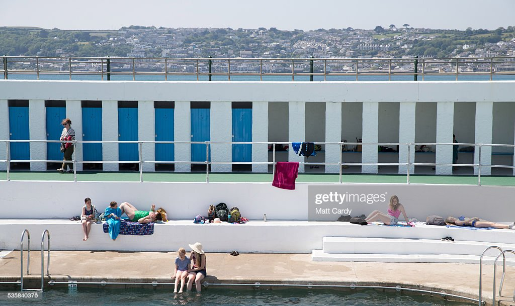 Bathers enjoy the fine weather at the recently reopened Jubilee Pool lido in Penzance on May 30, 2016 in Cornwall, England. The Grade II Listed Art Deco seaside pool that suffered structural damage in the storms of early 2014, reopened this weekend after a £3million refurbishment. The pool, the UK's largest surviving seawater pool and an iconic feature of the seafront since it first opened in 1935, has recently announced future plans to heat part of the it with geothermal energy.